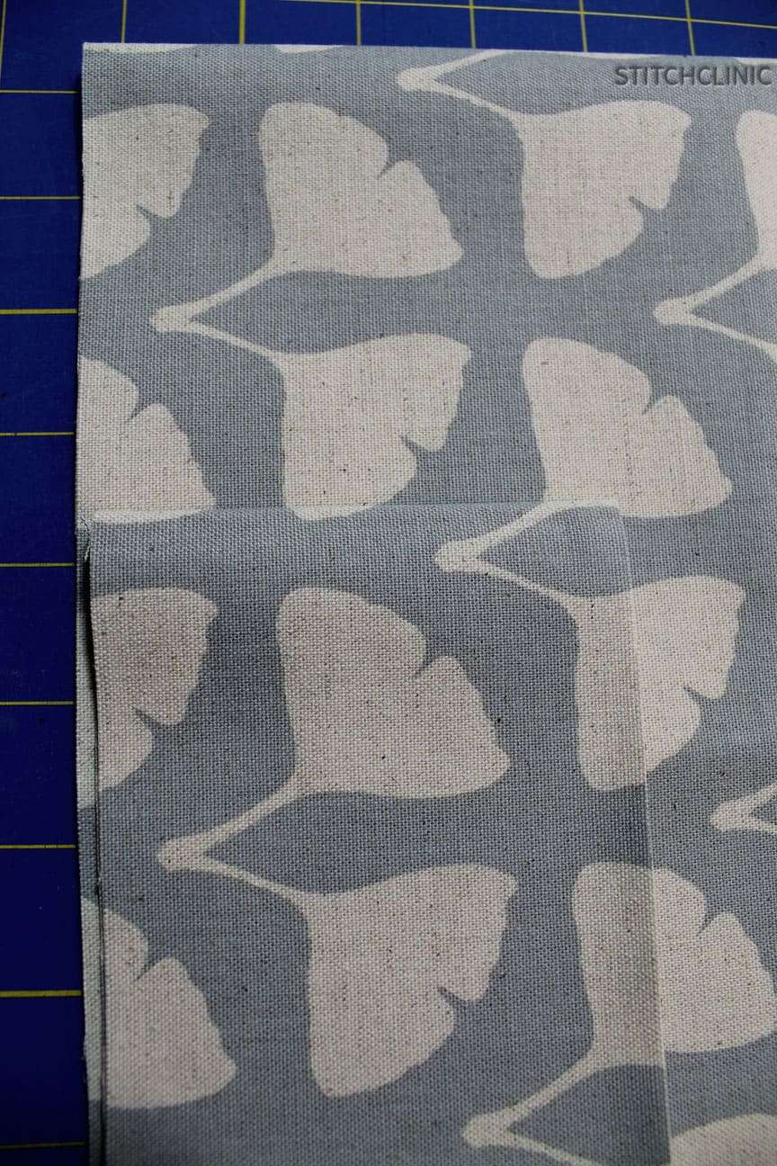 Light blue fabric with white ginko leaves