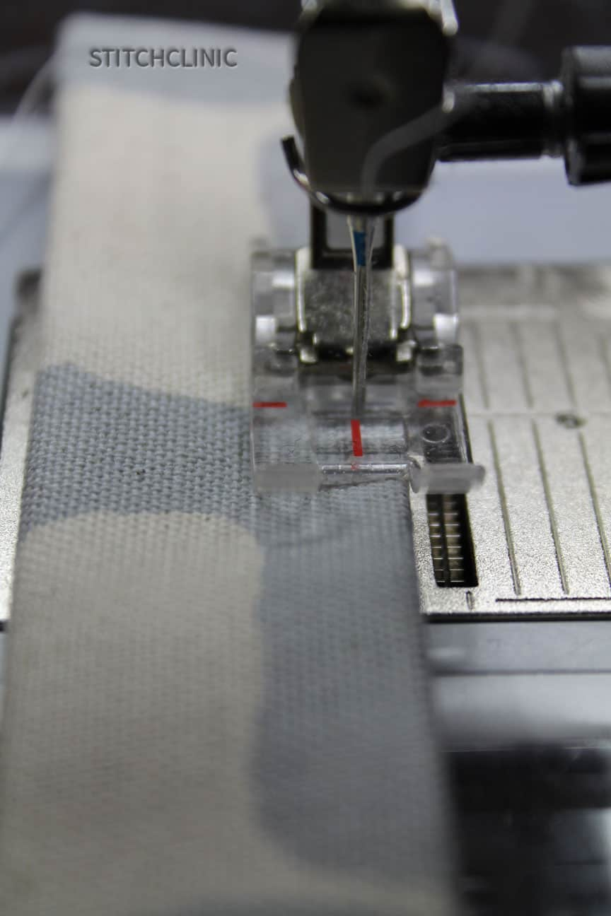 Close up of sewing the strap sides together