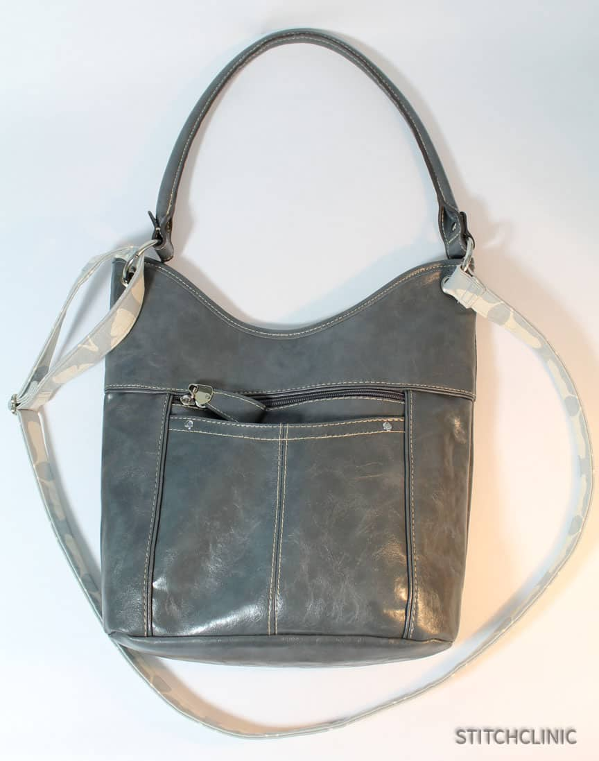 Converting a purse to a crossbody bag.