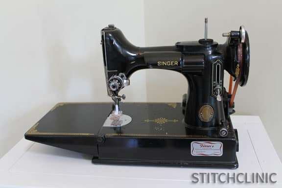Featherweight Machine by Singer -  small, black sewing machine