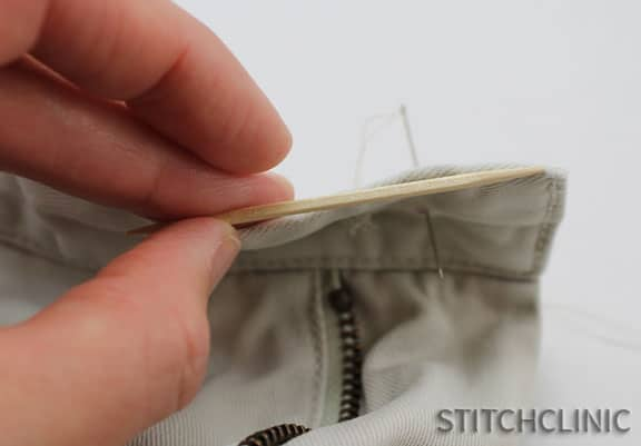 Showing how the thickness of a toothpick is about the same as the pants, important to make this work well.