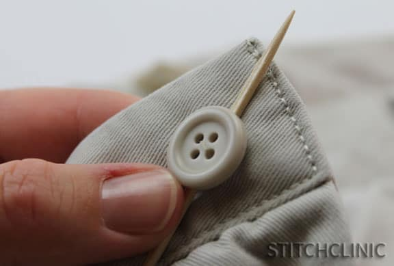 First stitch holding down the button.
