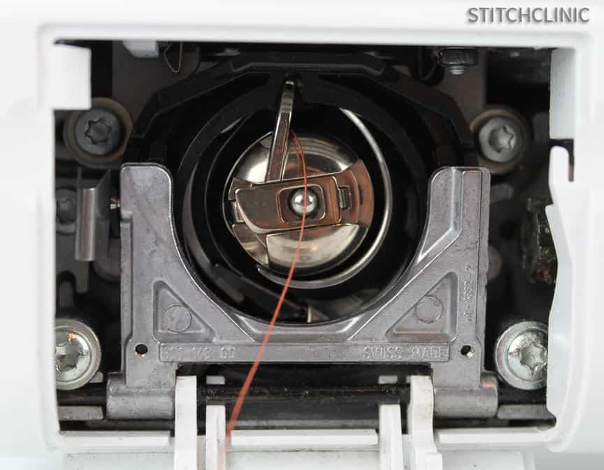 The inside of a sewing machine, bobbin case