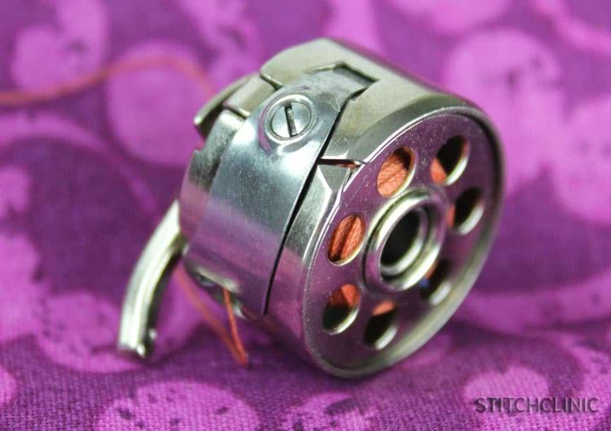 Bobbin case tension adjustment screw